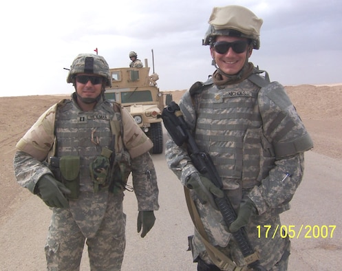 Maj. Paul Nichols, 961st Airborne Air Control Squadron, poses for a photo with a fellow service member. (Courtesy photo)