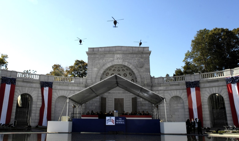 U.S. Army helicopters fly overhead during the ceremony Nov. 3 celebrating the 10th anniversary of the Women in Military Service for America Memorial at Arlington National Cemetery.  The helicopter pilots were all female and assigned to the 12th Aviation Battalion at Fort Belvoir, Va. (DOD photo/Cherie A. Thurlby)