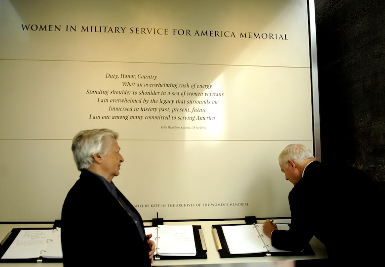 Secretary of Defense Robert M. Gates signs the guest book Nov. 3 as retired Brig. Gen. Wilma Vaught, president of Women in Military Service for America Memorial Foundation, looks on.  They were there the ceremony celebrating the 10th anniversary of the WIMSA Memorial at Arlington National Cemetery. (DOD photo/Cherie A. Thurlby)