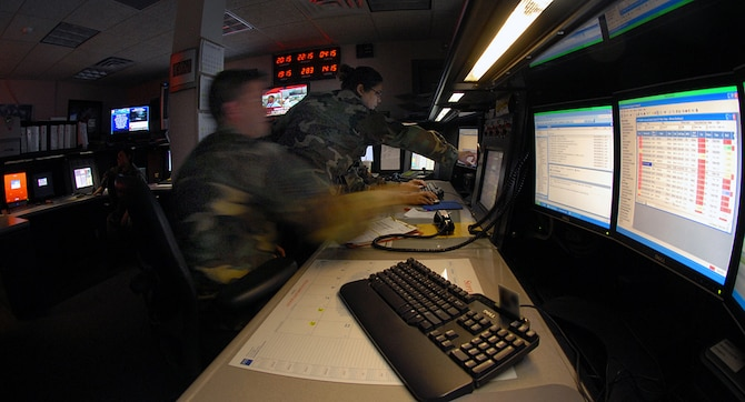 "375th Airlift Wing Command Post personnel monitor the ""heartbeat"" of the base as they conduct 24 hour a day control room activities."