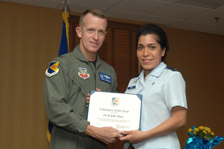 1st Lt Julie Kena accepts his award from Col. Kent Laughbaum, 355th Fighter Wing commander. (Courtesy photo)