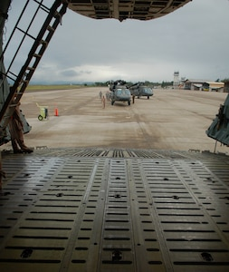 SOTO CANO AIR BASE, Honduras -- Two Army UH-60 Black Hawk helicopters sit on the tarmac here prior waiting to be loaded onto a C-5 Galaxy from the New York Air National Guard.  A team of 19 Airmen and Soldiers and two helicopters from Joint Task Force-Bravo departed here Nov. 5 heading for the Dominican Republic to assist with recovery efforts in the wake of Tropical Storm Noel. (U.S. Air Force photo/Staff Sgt. Austin M. May)