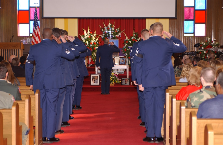 CANNON AIR FORCE BASE, N.M. -- Members of the 27th Civil Engineer Squadron's explosive ordnance disposal flight salute during the final roll call honoring U.S. Air Force Capt. Kermit Evans, Sr. during a memorial ceremony Dec. 15, 2006.  Evans was killed in action Dec. 3, 2006, while serving in Iraq. 