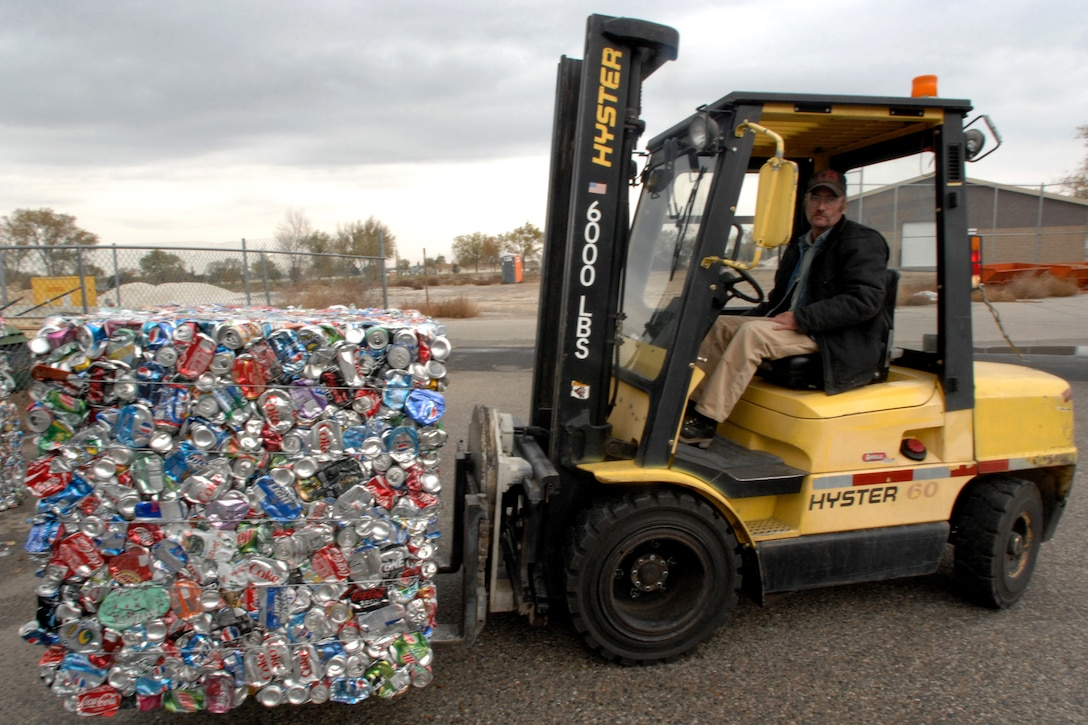 MOUNTAIN HOME AIR FORCE BASE, Idaho - Brent Richter, 366th Civil Engineer Squadron, moves a pile of aluminum cans for recycling at the base recycling center Oct. 30. America Recycles Day, which is celebrated Nov.15, has grown to include millions of Americans including Gunfighters pledging to increase their recycling habits at home and work and to buy products made with recycled materials. (U.S Air Force photo by Airman 1st Class Stephany Miller)