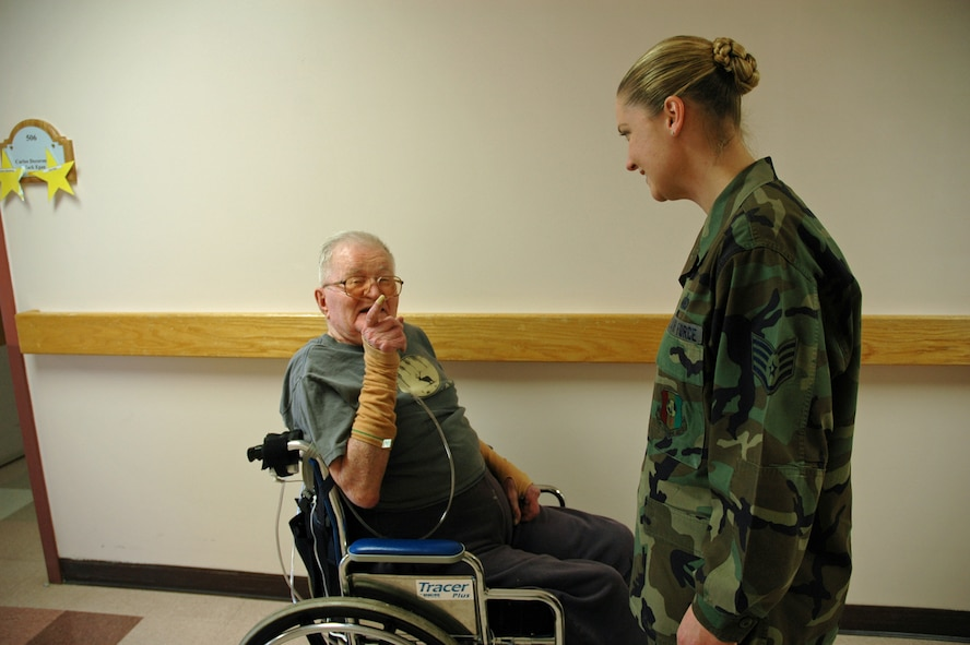Peter Baerg, a retired Soldier, tells Staff Sgt. Desiree Pogue, 392nd Training Squadron Det. 1, about his role in the Battle of the Bulge. (U.S. Air Force photo by Staff Sgt. Stacey Haga)