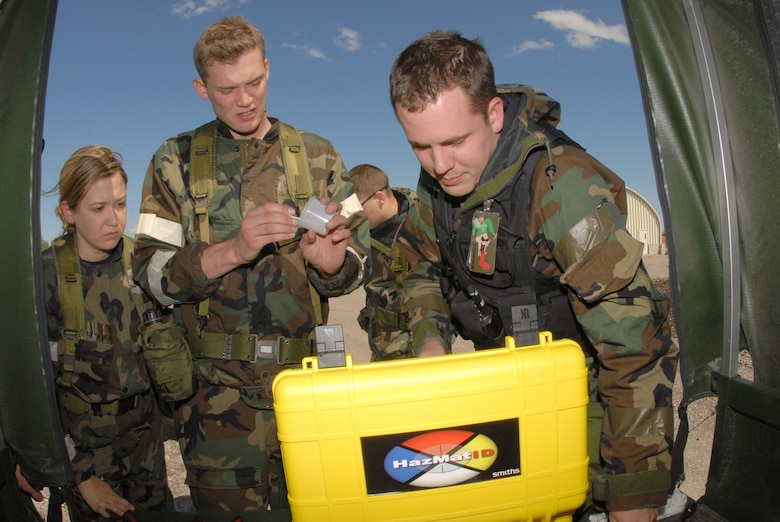 From left to right, Staff Sgt. Laura Radliff and Senior Airman Adam Logue, both of the 183rd Civil Engineer Squadron, along with Staff Sgt. Mathew Lasek, of the 138th Civil Engineer Squadron, use a HazMatID chemical substance identifying computer to test for evidence of weapons of mass destruction during a training exercise at the Air National Guard Regional Training Site, Fargo, N.D., May 23. (U.S. Air Force photo by Senior Master Sgt. David H. Lipp)
