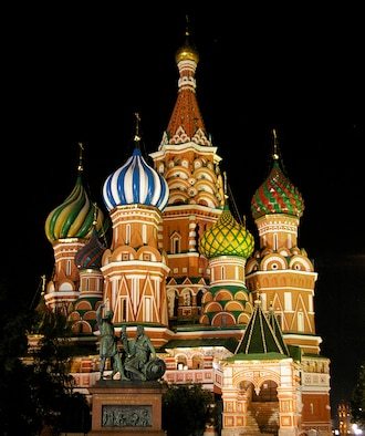 The multi-colored domes of St. Basil's Cathedral, standing opposite Resurrection Gate, are even more beautiful at night than during the day. The cathedral was commissioned by Ivan the Terrible to celebrate the capture of the Mongol stronghold of Kazan in 1552. The cathedral was completed in 1561 and, according to a Moscow guidebook, was reportedly designed by architect Postnik Yakovlev. (U.S. Air Force photo by Karen Abeyasekere)