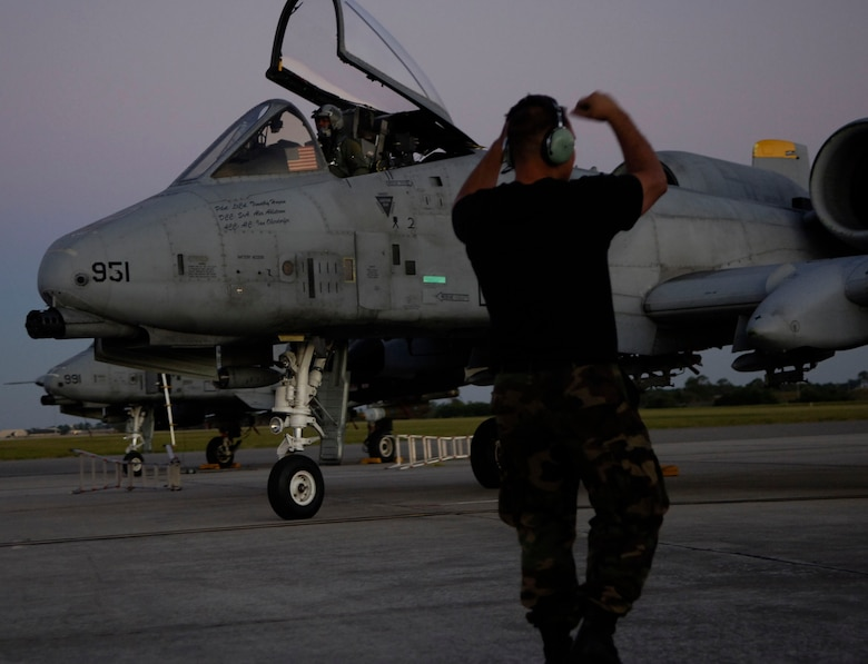 Senior Airman Alexander W. Ahlstrom, a crew chief from Spandahlem Air Base, Germany directs an A-10 towards the aircraft taxi lane before departure from MacDill AFB Fla. The A-10 unit is deployed to MacDill AFB to support exercise Atlantic Strike VI in Avon Park Fla. An F/A-18 Hornet taxies towards the runway at MacDill AFB Fla. in support of exercise Atlantic Strike VI, a U.S. Central Command Air Forces-sponsored exercise focusing on urban close air support operations. A-10 Thunderbolt II close air support aircraft are prepared for the next sortie as the Navy component departs for the Avon Park military ranges. (U.S. Air Force Photo By Airman 1st Class Stephenie Wade)