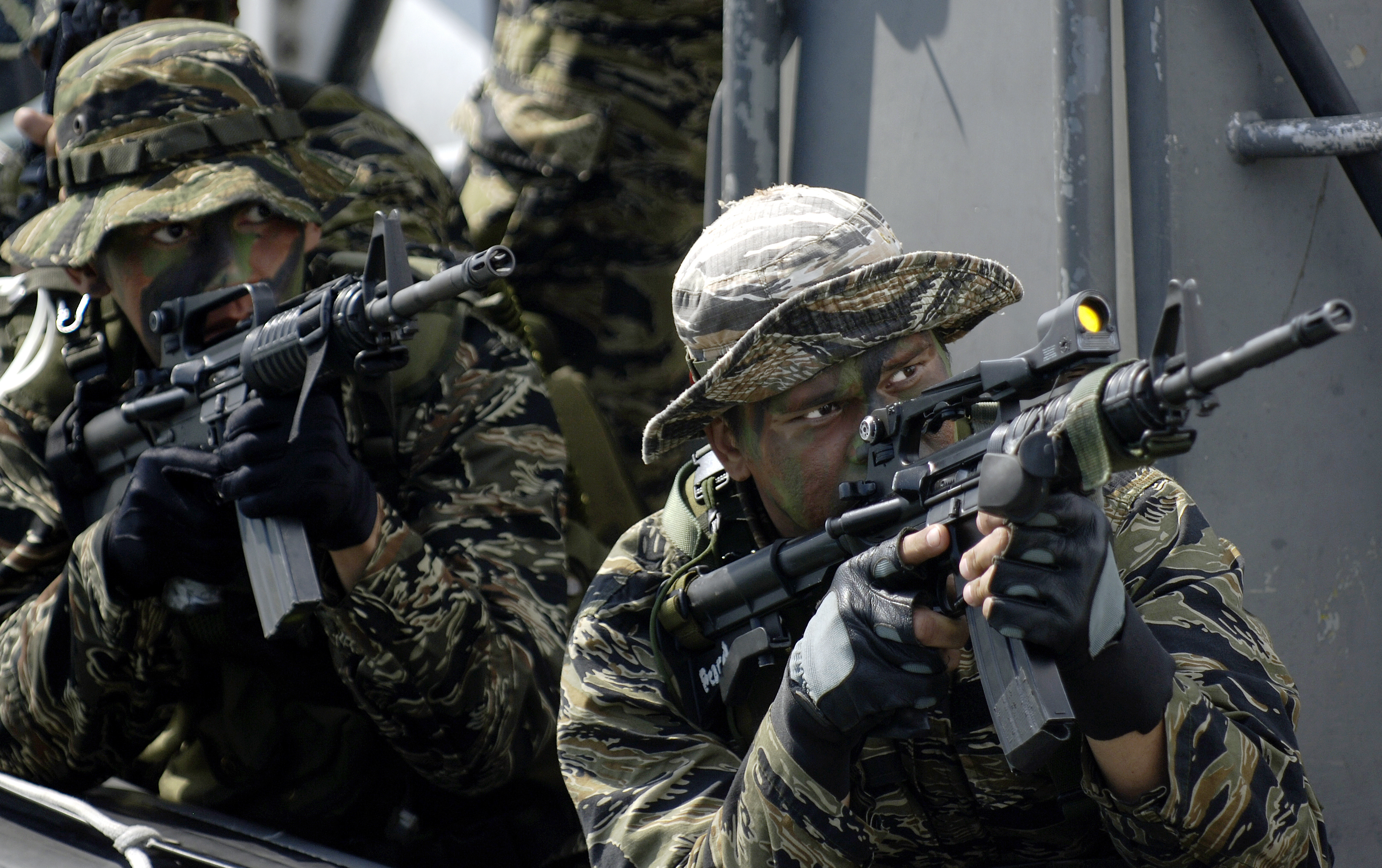 A Filipino Navy SEAL team demonstrates their capabilities to the