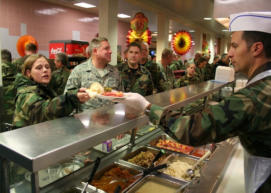 WRIGHT-PATTERSON AFB, Ohio - Maj Michael Brandenburg serves reservists during the lunchtime hour at the Pitsenbarger Dining Hall.  Commander's and First Sergeants serve airman at the dining hall during the November and December UTAs to show their appreciation for their service. (U.S. Air Force photo/Senior Airman Ken LaRock)