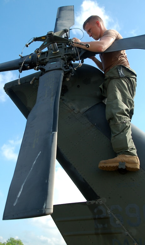 SAN ISIDRO AIR BASE, Dominican Republic -- Army Spc. Ian Shaffer, 1st Battalion-228th Aviation Regiment, secures the blades of the tail rotor on an Army UH-60 Black Hawk helicopter, preparing it for medical relief missions.  American servicemembers deployed from Joint Task Force-Bravo at Soto Cano Air Base, Honduras, to assist the Dominican Republic after it was ravaged by Tropical Storm Noel.  (U.S. Air Force photo by Staff Sgt. Austin M. May)