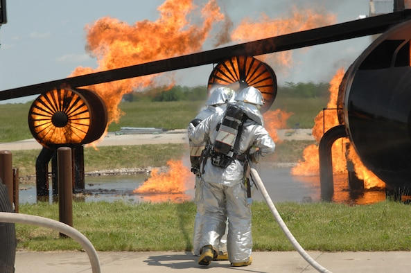 WHITEMAN AIR FORCE BASE, Mo. -- Members of the 509th Civil Engineer Squadron Fire Department put out an aircraft fire at the training pit during the Conventional Operation Readiness Inspection May 16. (U.S. Air Force photo/Tech. Sgt. Samuel A. Park)