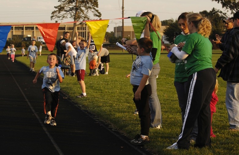 VANDENBERG AIR FORCE BASE, Calif. -- Trenton Lee, 7, runs toward the finish line after running four laps during the Land Sharks final track meet on Oct. 29. Each child that finishes a race gets a ribbon. (U.S. Air Force photo/Airman 1st Class Christian Thomas)