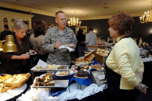 SHAW AIR FORCE BASE, S.C. -- Ms. Ginny Shirley, 20th Fighter Wing Protocol, and Col. Francis Xavier, 20th Mission Support Group commander, sample various desserts during a taste panel at the Carolina Skies Club, Nov. 14. Chefs at Carolina Skies prepared new menus of appetizers, hors d'oeuvres, main course dishes and desserts to be reviewed by senior leadership. Items receiving the highest marks will be added to the Carolina Skies menu. (U.S. Air Force photo/Airman 1st Class Kathrine McDowell)