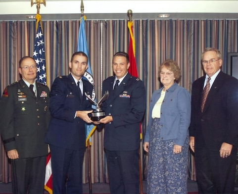 (L-R): Army Lt. Gen. Keith Alexander, DIRNSA & JFCC-NW, poses with Air Force Maj. Carl Grant,  33rd Network Warfare Squadron commander, Air Force Capt. David Trollman, AF Network Prevention & Response Flight flight-commander, Ms. Joan Ruhl, NSA deputy information assurance director, and Thomas Rowlett, son of Frank B. Rowlett, after presenting the Frank B. Rowlett Award for Outstanding Information Assurance Organization. (courtesy photo)