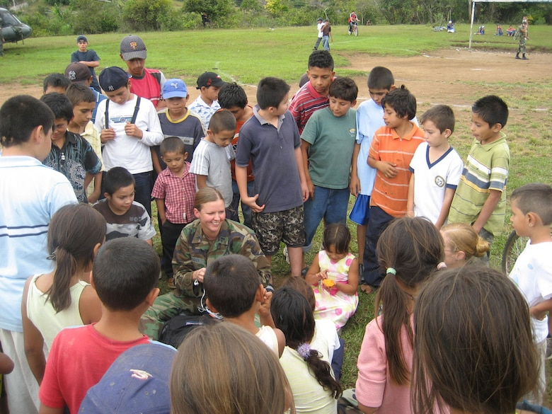 CORINTO, El Salvador -- Air Force 1st Lt. Vanessa Johnson, chief of medical logistics at the Medical Element from Joint Task Force-Bravo, talks with local children here Nov. 6 following a a medical readiness training exercise.  MEDEL provided medical care for 2,690 El Salvadorans. (Courtesy photo)