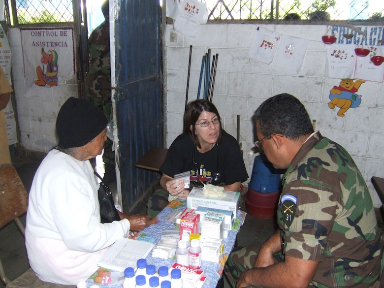 CORINTO, El Salvador - Air Force Capt. Denise Lane, a nurse with the Medical Element at Soto Cano Air Base, Honduras, talks with patients during a recent Medical Readiness Training Exercise here Nov. 5-6. (Courtesy photo)