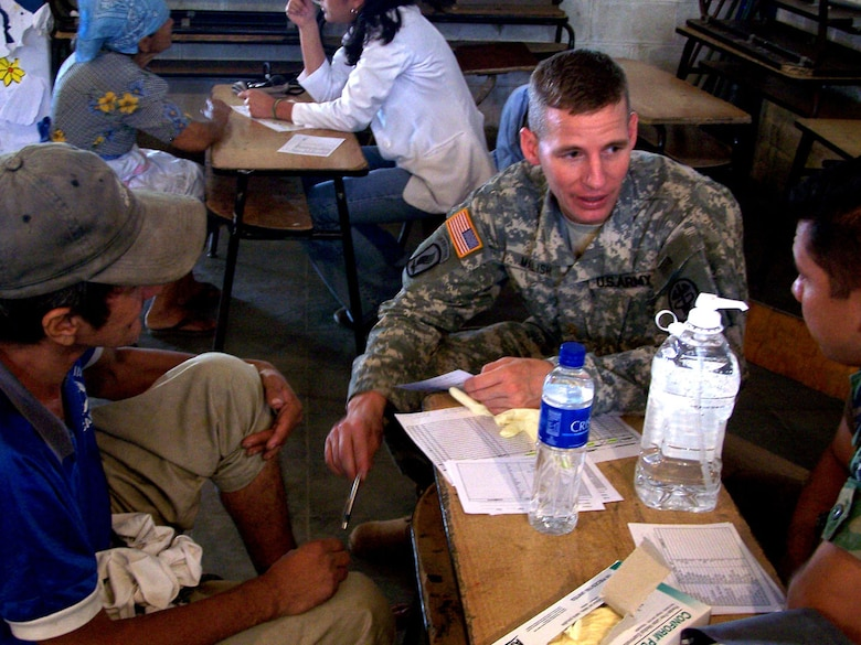 CORINTO, El Salvador - Army Maj. (Dr.) Richard Malish, a surgeon with the Medical Element at Soto Cano Air Base, Honduras, talks with patients during a recent Medical Readiness Training Exercise here Nov. 5-6. (Courtesy photo)