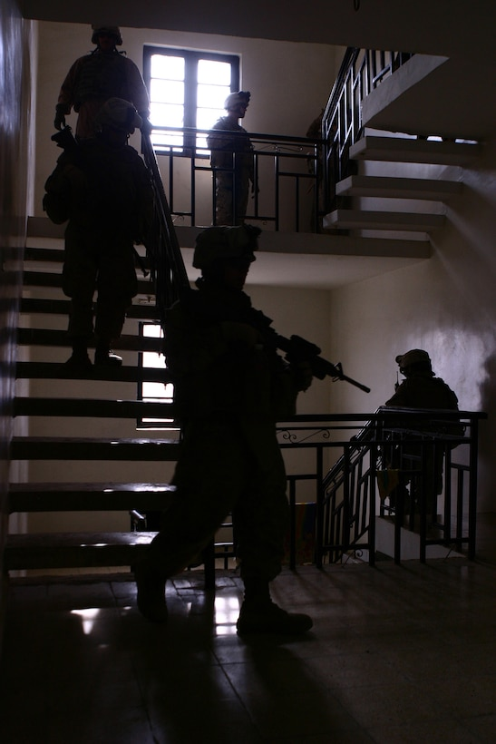 Marines with Company K, 3rd Battalion, 5th Marine Regiment, Regimental Combat Team 6, descend a stairwell of a Fallujah resident?s three-story home, Nov. 15. The Marines visited the home while on patrol through their neighborhood to speak with the residents to collect census information from the area. Marines with the ?Darkhorse? battalion are working to transition security completely to the Iraqi Police.