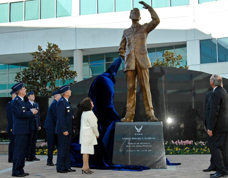 A statue of the late General Bernard A. Schriever is unveiled at a ceremony held at Los Angeles AFB, Nov. 15. General Schriever is considered the father of the Air Force's space and missile program. The statue was donated to SMC by the Air Force Association's Schriever Chapter. (Photo by Lou Hernandez)