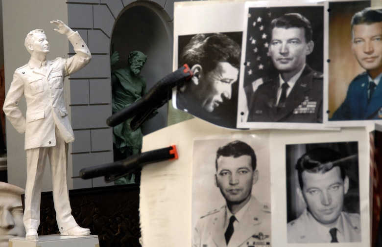 Local sculptor Eugene Daub used several photos of General Schriever to create his work. The finished product was dedicated at a ceremony at Los Angeles AFB, Nov. 15. It was donated to SMC by the Air Force Association's Schriever Chapter. (Photo by Lou Hernandez)