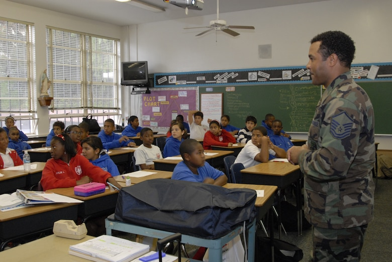Master Sgt. Ricardo Wright, 61st Communications Squadron, talks to students at St. Jerome's Catholic School in Westchester. Approximately 20 military members, including ten Air Force personnel, spoke to students about their military career and the importance of education. The service members were recognized as a group at a school assembly. (Photo by Joe Juarez)