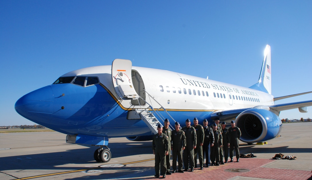 """Vice commanders and members of Air Force Reserve Command's 932nd Airlift Wing welcomed a new """"baby"""" to Illinois recently.  They are proud parents of a brand new C-40C aircraft which arrived straight from the factory.  Photo/Capt. Stan Paregien"""