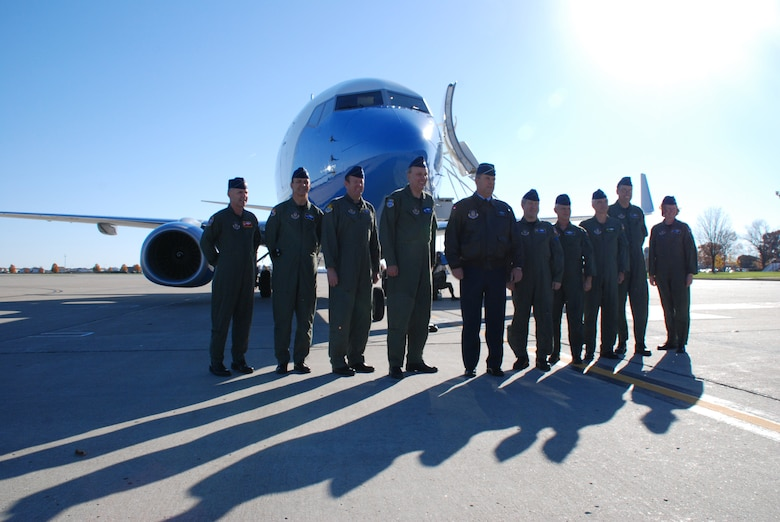 Vice commanders from Air Force Reserve Command gather with Maj. Gen. Robert Duignan (center) as the 932nd Airlift Wing received its third C-40C distinguished visitor airlift plane at Scott Air Force Base recently.  The general piloted the new plane from the factory to the wing in Illinois.  Photo/Capt. Stan Paregien