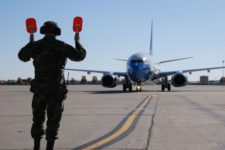 Senior Master Sgt. Bill Treakle of the maintenance squadron, 932nd Airlift Wing, directs the third C-40C to its parking spot right after it landed with Maj. Gen. Robert Duignan at the controls.  The Fourth Air Force commander flew the new plane from the factory to the Illinois Air Force Reserve unit on November 16, 2007.  Photo/Capt. Stan Paregien