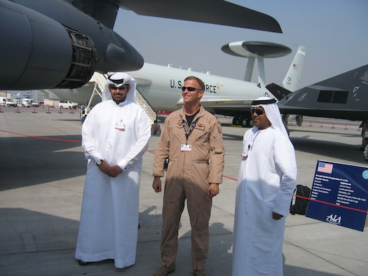 Colonel Robert Craig, director of exercises and engagements, U.S. Central Command Air Forces, an on-scene commander for the U.S. military contingent talks with two Dubai police officers. The police officers are part of the team responsible for security at the Dubai Air Show and will ensure the security of U.S. aircraft upon departure from Dubai. More than 250 Airman, Soldiers and Sailors and various Air Force and Navy aircraft from bases in the Persian Gulf region and  the United States are supporting the air show from Nov 11-15.  The United States military is a long-standing participant in the biennial Dubai Air Show.  (Air Force Photo by Chief Master Sgt. Renee Tyron)