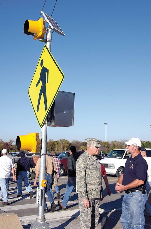 Maj. Gen. Loren Reno, Oklahoma City Air Logistics Center commander, talks about the new crossing signals with Rick Stuart, American Federation of Government Employees Local 916 second vice president. General Reno pushed the walk button Nov. 8 and joined dozens of OC-ALC employees as they crossed the street to head home. (Air Force photo by Margo Wright)