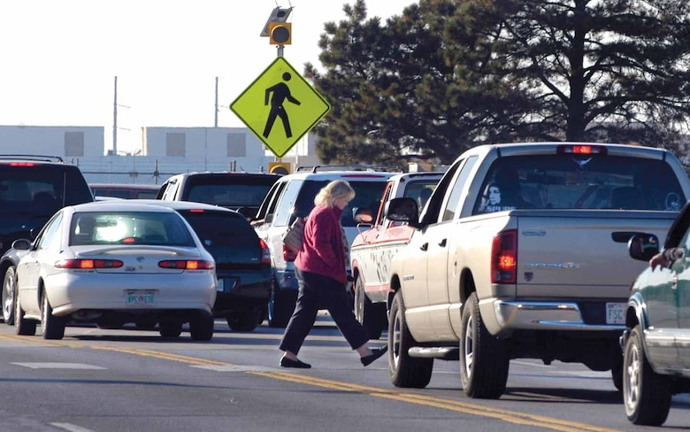 Pedestrians have the right-of-way when crossing roads in designated crosswalks, but those crossing need to be sure drivers see them before stepping into the street. (Air Force photo by Margo Wright)