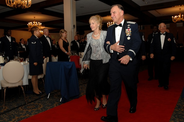 General William T. Hobbins, United States Air Forces in Europe commander, and his wife Robin make their way up the red carpet during the Order of the Sword ceremony Nov. 17 at Ramstein Air Base, Germany. General Hobbins received the Order of the Sword from Command Chief Master Sgt. Gary Coleman and command chiefs stationed in USAFE. (U.S. Air Force photo/Airman 1st Class Kenny Holston)