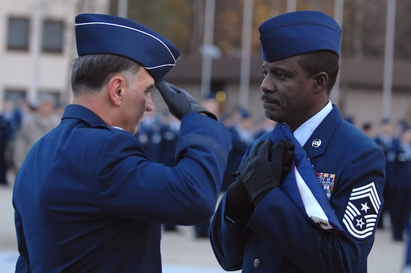 U.S. Air Forces in Europe Commander Gen William T. Hobbins salutes the flag after presenting it to USAFE Command Chief Master Sergeant Gary G. Coleman during a retreat ceremony.  The retreat ceremony followed a retirement ceremony honoring Chief Coleman for 30 years of military service.  The chief's retirement is effective May 1, 2008. (U.S. Air Force photo by Tech Sgt. Corey Clements)