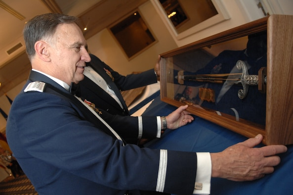 U.S. Air Forces in Europe Commander, General William T. Hobbins, admires a sword he received during a USAFE order of the sword induction ceremony in his honor.  The sword represents truth, justice, and rightfully used power and induction into the order is the highest honor an enlisted organization or command can bestow on an individual. (U.S. Air Force photo by Tech Sgt. Corey Clements)