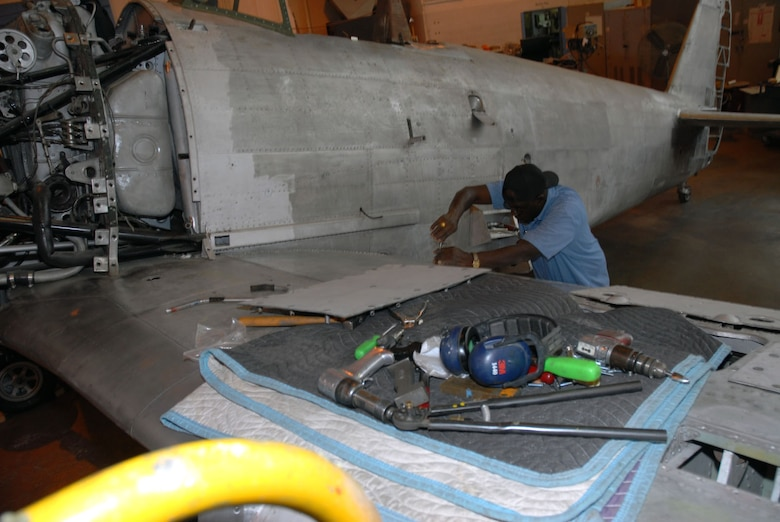 DAYTON, Ohio (11/2007) -- Restoration specialist Bobby Anderson works on the Japanese George in the restoration area of the National Museum of the United States Air Force. (U.S. Air Force photo)