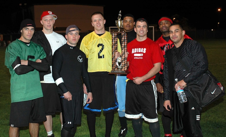 The Travis Red All-Stars pose with their trophy after earning a 14-12 victory over the Gold All-Stars during the Intramural Flag Football All-Star Classic Nov. 20. (U.S. Air Force photo/Staff Sgt. Candy Knight)