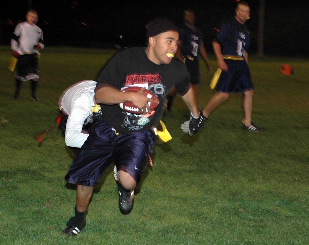 Brandon Chavez, Travis Gold All-Stars' halfback, runs for a 40-yard gain during the Intramural Flag Football All-Star Classic Nov. 20. Chavez had 95 total rushing yards and an interception return for a touchdown. The Red All-Stars defeated the Gold All-Stars 14-12. (U.S. Air Force photo/Staff Sgt. Candy Knight)