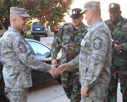 Chief Master Sgt. Todd A. Kabalan, left, is greeted by senior enlisted personnel from the 552nd Communications Group during his early morning visit to their facility. The 8th Air Force command chief visited Tinker Nov. 14-16. (Air Force photo by 2nd Lt. Kinder Blacke)