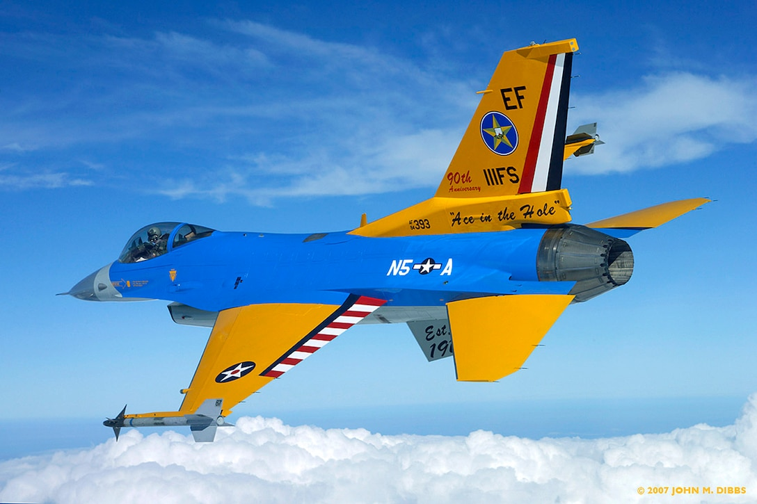 An F-16C Fighting Falcon from the Texas Air National Guard's 111th Fighter Squadron flies with a special paint job in honor of the squadron?s 90th anniversary. All the colors and markings have specific meanings, reflecting the unit?s nine-decade history.  (Photo courtesy of John Dibbs)
