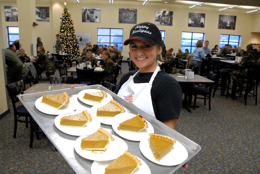 Airman 1st Class Trisha K. McDonald brings out the pumpkin pie Nov. 18 during the Thanksgiving holiday meal prepared for North Dakota Air National Guardsmen of the 119th Wing at Fargo.  (U.S. Air Force photo/Senior Master Sgt. David H. Lipp)