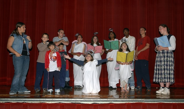 """Cast members of """"The Best Christmas Pageant Ever"""" practice Nov. 14 in anticipation of their Dec. 14 opening night. The Christmas comedy is produced by the Lackland Performing Arts Group. Show dates are Dec. 14 and 15 at 7 p.m., Dec. 16 at 2 p.m., and Dec. 21 and 22 at 7 p.m. at the Bob Hope Performing Arts Theater. Doors open one hour prior to the show. Tickets are $3 for adults and $2 for senior citizens and children 13 and younger. (USAF photo by Alan Boedeker)"""