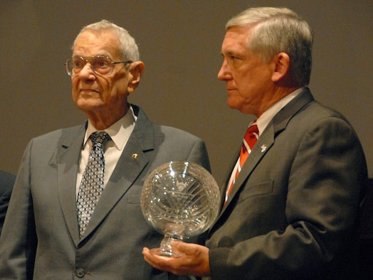 Retired Chief Master Sgt. of the Air Force Paul Wesley Airey receives the Air Force Association's Lifetime Achievement award from AFA's Chairman of the Board Robert Largent during a Nov. 20 ceremony at Maxwell-Gunter's Senior NCO Academy in Alabama. Chief Airey was the first chief master sergeant of the Air Force, and is the first enlisted member to receive the AFA award. (U.S. Air Force photo/Master Sgt. Scott Moorman)