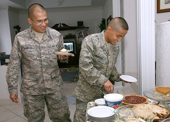 Air Force Trainees Ublabo Barraza, left, and Keno Enriquez have a choice of pumpkin, apple and pecan pies during Thanksgiving dinner at Master Sgt. Tammi and Tech. Sgt. Roy Barnett's home in San Antonio, Texas. The trainees are assigned to the 331st Training Squadron, Flight 065. Sergeant Tammi Barnett works in the 340th Flying Training Group at Randolph AFB. Sergeant Roy Barnett is assigned to the Air Force Personnel Center at Randolph AFB. (USAF photo by Robbin Cresswell)