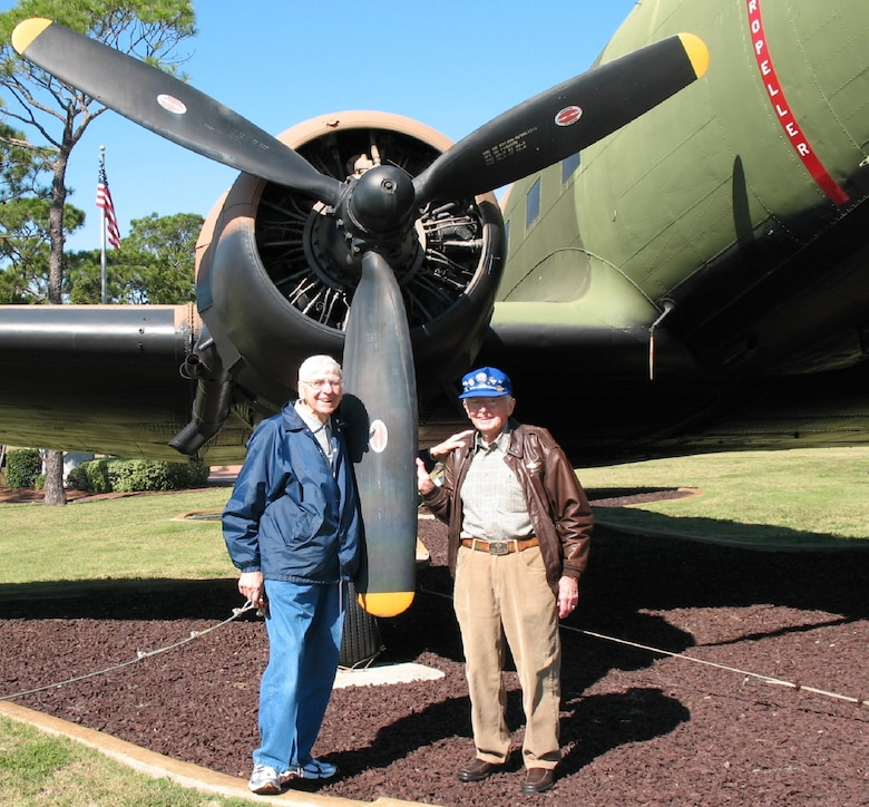 Staff Sgt. Mike Ingrisano and Lt. Bill Prindible with an old friend, a C-47, tail number 43-15510, located in the Hurlburt Field Memorial Air Park. (Courtesy photo)