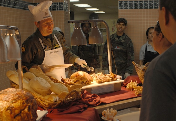 On Thanksgiving Day, Brig. Gen. Doug Owens, 36th Wing commander, and other senior leaders served hot meals to Andersen military members at the Magellan Inn Dining Facility. (U.S. Air Force photo/Senior Airman Angelique Smythe)