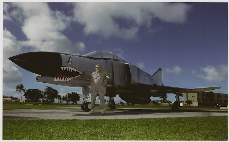 Chief Master Sergeant of the Air Force Rodney J. McKinley, then Pacific Air Forces Command Chief in this January 2006 photo, takes a moment out of his busy schedule to view the F-4E Phantom he launched from Clark Air Base, Republic of the Philippines in April 1991. Chief McKinley said he has a special place in his heart for the F-4 Phantom and even keeps a model of one on his desk at the Pentagon. This historical aircraft recently received an updated paint scheme to reflect Andersen's current mission. (Courtesy photo/Office of the Chief Master Sergeant of the Air Force Public Affairs Advisor)