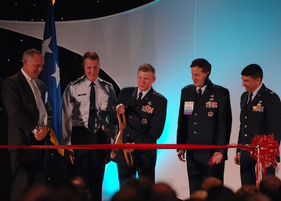 "(L-R)Craig Spohn, Cyber Innovation Center director, Lt. Gen. Ted Bowlds, Electronic Systems Center commander, Maj. Gen. William Lord, Air Force Cyber Command (provisional) commander, and Col. Paul Suarez, Air Force Network Operations commander, look on as Lt. Gen. Robert Elder, Headquarters Eighth Air Force commander cuts the ribbon at the ""Fly and Fight in Cyberspace"" Symposium Nov. 28 in Shreveport, La.  More than 1,700 people attended the three-day event. (U.S. Air Force photo/Airman First Class Joanna M. Kresge)"