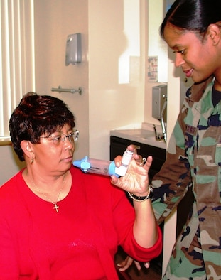 Senior Airman Destini Monteiro, 60th Medical Operations Squadron cardiopulmonary technologist, provides metered-dose inhaler treatment and self-medication instructions on the use of an Aerochamber Spacer to Renda Ruffin at David Grant USAF Medical Center. During the flu season, senior citizens are more vulnerable to respiratory problems, dangerous forms of pneumonia and conditions like chronic obstructive pulmonary disease. (U.S Air Force photo/Master Sgt. Austin Delacruz Jr.)