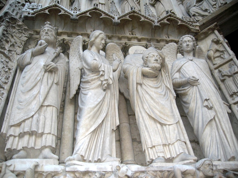 """PARIS – Saint Denis, """"The Headless Saint,"""" was the first Bishop of Paris. He became a martyr after being beheaded by a sword in approximately 250. This Saint Denis statue is part of the architecture of the Notre Dame Cathedral. (U.S. Air Force photo/Staff Sgt. Tammie Moore)"""
